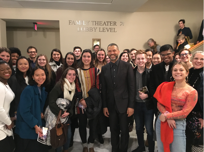 Image of diverse group of students clustered together around jazz musician Jason Moran